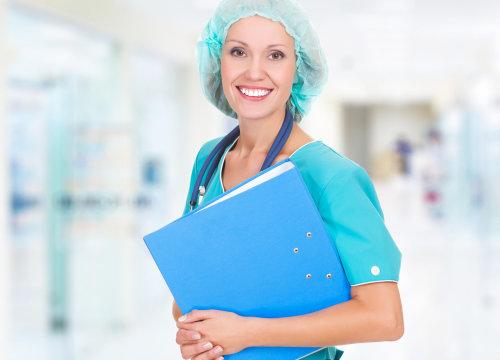 medical staff smiling while bringing a folder